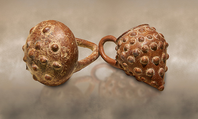 Bronze Age Anatolian terra cotta basket with handle & a beaker shaped as a bunch of grapes - 19th to 17th century BC - Kültepe Kanesh - Museum of Anatolian Civilisations, Ankara, Turkey.  Against a warn art background.
