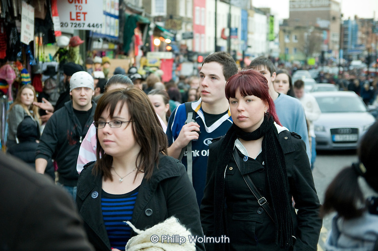 Young people crowd Camden High Street on a Sunday afternoon