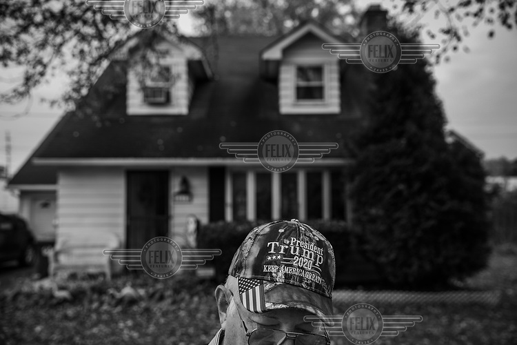 Verel Salmon (72), Erie County's GOP (Republican party) chairman, wearing a Trump 2020 cap in front of his house.
