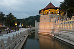 10 March 2015, Kandy, Sri Lanka:   The Temple of the Sacred Tooth Relic, just after sunset in Kandy, Central Province, Sri Lanka. It is located in the royal palace complex of the former Kingdom of Kandy, which houses the relic of the tooth of Buddha. Since ancient times, the relic has played an important role in local politics because it is believed that whoever holds the relic holds the governance of the country. Kandy was the last capital of the Sri Lankan kings and is a UNESCO world heritage site mainly due to the temple.Picture by Graham Crouch for the New York Times