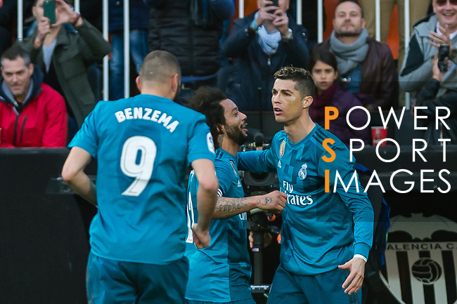 Cristiano Ronaldo of Real Madrid (R) celebrates after scoring his goal with his teammates during the La Liga 2017-18 match between Valencia CF and Real Madrid at Estadio de Mestalla  on 27 January 2018 in Valencia, Spain. Photo by Maria Jose Segovia Carmona / Power Sport Images