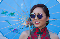 Portrait of Asian Woman with Blue Umbrella, Chinatown Seafair Parade, Seattle, WA, USA.