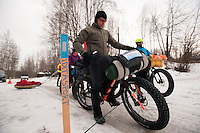 Competitors chat line up at the start of the 200-mile Iditasport Human Powered Race in Knik, Alaska. The 2014 event is a revival of the legendary 1980's race, which was the first of its kind to put foot and bicycle power to the test against a trail normally only traversed by dogsled or snowmachine. The original competition paved the way for other endurance races in the far north and spurred a number of innovations in outdoor equipment, including the now-ubiquitous fat tire bicycle.