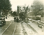 The twin trolley tracks being extracted for salvage on Willow Street, north of Plaza Avenue looking south. 29 July 1937 (WA)