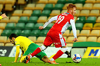 3rd November 2020; Carrow Road, Norwich, Norfolk, England, English Football League Championship Football, Norwich versus Millwall; Ryan Woods of Millwall goes past the tackle from Emi Buendia of Norwich City