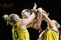 Melbourne, 15 August 2015 - Rachel JARRY and Suzy BATKOVIC of Australia fight for the ball in game one of the 2015 FIBA Oceania Championships in women's basketball between the Australian Opals and the New Zealand Tall Ferns at Rod Laver Arena in Melbourne, Australia. Aus def NZ 61-41. (Photo Sydney Low / sydlow.com)