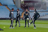 Re: Saturday 21st March 2015 <br /> Pictured:  Jordi Amat, Angel Rangel and Nelson Oliveira of Swansea City  play around  before the match <br /> Re: Barclays Premier League Aston Vila v Swansea City at Villa Park, Birmingham, UK