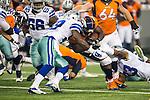 Dallas Cowboys and Denver Broncos in action during the pre-season game between the Denver Broncos and the Dallas Cowboys at the AT & T stadium in Arlington, Texas.