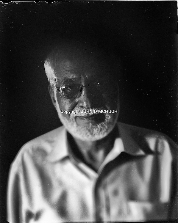 "Omar Khan Massoudi, Director of the National Museum of Afghanistan, is seen in his office in Kabul, 26 August 2012. This portrait was shot on a 5x4 Linhof Technika IV, circa 1959, and a Schneider Kreuznach 270mm lens, circa 1952, with front tilt, and is part of a series entitled ""Putting an Afghan face on the war."" (John D McHugh)"