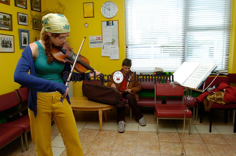 Nora Mathews tunes up before music class during the Fleadh Nua in Ennis. Photograph by John Kelly.