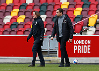 14th February 2021; Brentford Community Stadium, London, England; English Football League Championship Football, Brentford FC versus Barnsley; Brentford Manager Thomas Frank and Barnsley Manager Valerien Ismael walking onto pitch after the final whistle