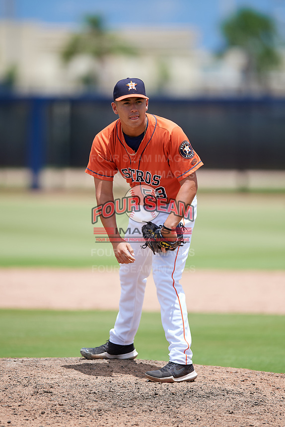 GCL Astros relief pitcher Miguel Figueroa (58) looks in for the sign during a game against the GCL Nationals on August 6, 2018 at FITTEAM Ballpark of the Palm Beaches in West Palm Beach, Florida.  GCL Astros defeated GCL Nationals 3-0.  (Mike Janes/Four Seam Images)