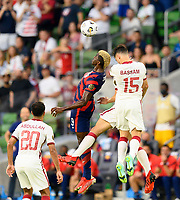 AUSTIN, TX - JULY 29: Gyasi Zardes #9 of the United States goes up for a header in front of Bassam Al Rawi #15 of Qatar during a game between Qatar and USMNT at Q2 Stadium on July 29, 2021 in Austin, Texas.