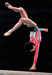 A gymnast flips in the balance beam competition at the 1988 Seoul Olympics