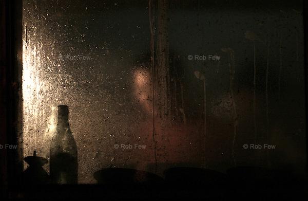 Scene seen through a restaurant window in a Beijing hutong.