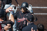 Braylen Wimmer (3) of the South Carolina Gamecocks is greeted by teammates after hitting a home run against the Vanderbilt Commodores at Hawkins Field on March 21, 2021 in Nashville, Tennessee. (Brian Westerholt/Four Seam Images)