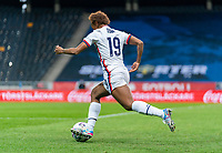 SOLNA, SWEDEN - APRIL 10: Crystal Dunn #19 of the USWNT dribbles during a game between Sweden and USWNT at Friends Arena on April 10, 2021 in Solna, Sweden.