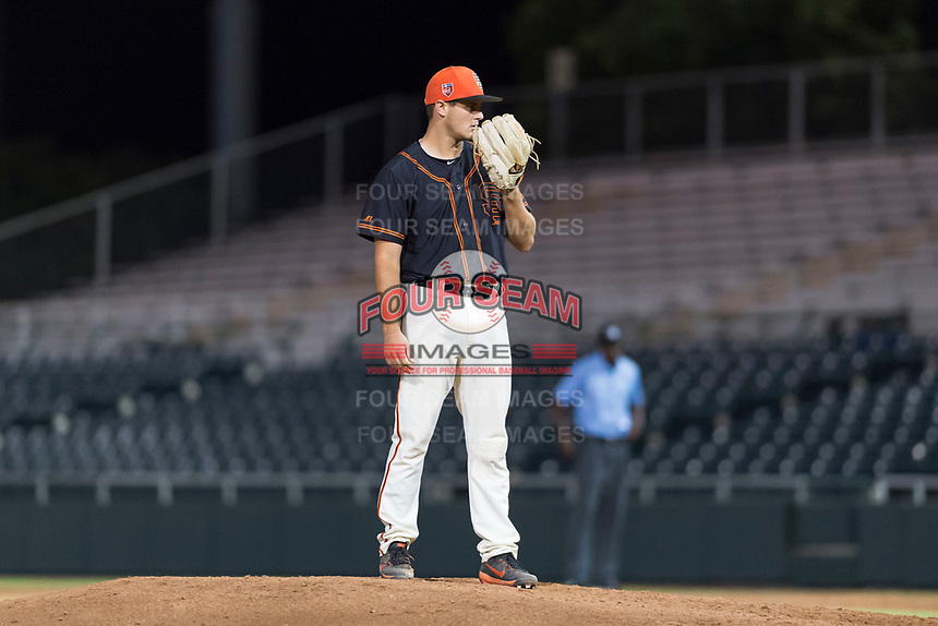 AZL Giants Black relief pitcher Cooper Casad (62) looks in for the sign during an Arizona League game against the AZL Rangers at Scottsdale Stadium on August 4, 2018 in Scottsdale, Arizona. The AZL Giants Black defeated the AZL Rangers by a score of 6-3 in the second game of a doubleheader. (Zachary Lucy/Four Seam Images)