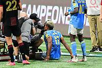 ATLANTA, GA - APRIL 27: Philadelphia medical personnel attend to injured forward #17 Sergio Santos during a game between Philadelphia Union and Atlanta United FC at Mercedes-Benz Stadium on April 27, 2021 in Atlanta, Georgia.