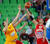 "Pablo Aguilar of Spain (L) and Roko Leni Ukic of Croatia (R) in action during European basketball championship ""Eurobasket 2013""  basketball game for 3rd place between Spain and Croatia in Stozice Arena in Ljubljana, Slovenia, on September 22. 2013. (credit: Pedja Milosavljevic  / thepedja@gmail.com / +381641260959)"