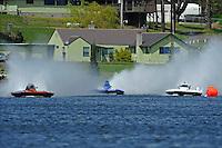 "Jim Mauldin, E-31, Brian Perkins, E-82, and Jeff Bernard, E-1 ""MY-Way"" race out of the first turn."