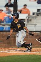 Enyel Vallejo (15) of the Bristol Pirates follows through on his swing against the Johnson City Cardinals at Howard Johnson Field at Cardinal Park on July 6, 2015 in Johnson City, Tennessee.  The Pirates defeated the Cardinals 2-0 in game one of a double-header. (Brian Westerholt/Four Seam Images)