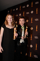 Sophie Nelisse (L) and  Emilien Neron (R) receive the JUTRA Award of best supporting actors for their role in Philippe Falardeau's MONSIEUR LAZHAR, March 11, 2012.