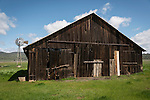 Weathered wooden barn and 1897 Aermotor open-backgear windmill, Salt Spring Valley, California.
