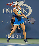 Caroline Wozniacki (DEN) battles against Camila Georgi (ITA) at the US Open being played at USTA Billie Jean King National Tennis Center in Flushing, NY on August 31, 2013