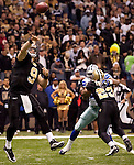 December 2009: New Orleans Saints quarterback Drew Brees (9) passes the ball during an NFL football game at the Louisiana Superdome in New Orleans.  The Cowboys defeated the Saints 24-17.