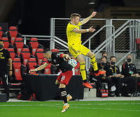 WASHINGTON, DC - OCTOBER 28: Chris Cadden #2 of Columbus Crew SC battles for the ball with Joseph Mora #28 of D.C. United during a game between Columbus Crew and D.C. United at Audi Field on October 28, 2020 in Washington, DC.