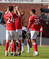 24th April 2021, Oakwell Stadium, Barnsley, Yorkshire, England; English Football League Championship Football, Barnsley FC versus Rotherham United; Michał Helik of Barnsley celebrates at the final whistle with Aapo Halme of Barnsley