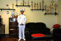 Bolivian Navy Captain Miguel Alvarez poses in his office at the naval base in San Pedro de Tiquina on Lake Titicaca. Bolivia lost what is now northern Chile in a war over nitrates leaving Bolivia without access to the ocean.