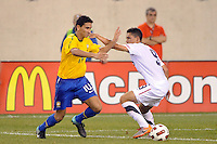 Paulo Henrique Ganso (10) of Brazil and Herculez Gomez (9) of the United States. The men's national team of Brazil (BRA) defeated the United States (USA) 2-0 during an international friendly at the New Meadowlands Stadium in East Rutherford, NJ, on August 10, 2010.