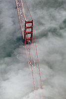 aerial photograph of fog passing through the Golden Gate bridge, San Francisco, California