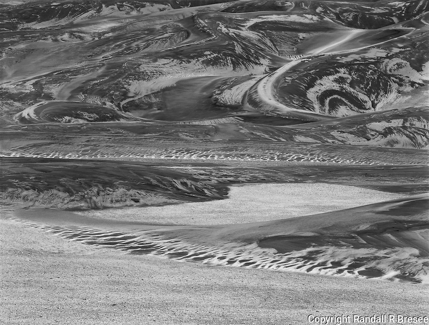 """""""Serpents In The Sand"""" <br /> Great Sand Dunes National Park, Colorado <br /> <br /> The Great Sand Dunes offer visitors a myriad of visually complex scenes. Sand is sculpted by various forces into an endless number of fantastic shapes and textures. This black and white photo shows that the dunes stimulated the imagination of this photographer mightily."""