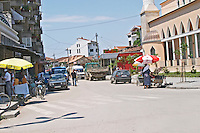 A street with cars, street market and a mosque. Shkodra. Albania, Balkan, Europe.