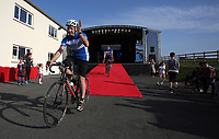Martin Snailham cycles off the stage