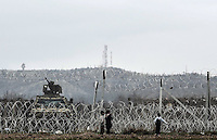 Pictured: Children play by the barbed wire fence Monday 07 March 2016<br /> Re: Refugees at the Greek FYRO Macedonian border in Idomeni, Greece.