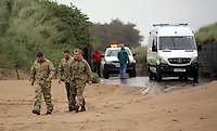 "Pictured: Bomb experts arrive at Cefn Sidan beach, near Pembrey west Wales, UK. Saturday 21 May 2016<br /> Re: A suspected bomb washed up on a Welsh beach has been detonated a bomb disposal unit after a walker came across it at Cefn Sidan beach, west Wales.<br /> After the discovery, the beach, aprt of Pembrey Country Park in Carmarthenshire , was cordoned off.<br /> The device was subsequently detonated.<br /> A spokesman for HM Coastguard Swansea said: ""The bomb disposal team is on the scene dealing with the object and it has just been detonated.""<br /> ""We will now be clearing up the debris and making sure the beach is clean and safe."""