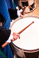 Drum and drumsticks played by a girl during the Palio's parade