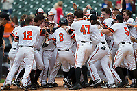 Hunter Hearn (8) of the Sam Houston State Bearkats is mobbed by his teammate at home plate following his walk-off 2-run home run against the Vanderbilt Commodores in the bottom of the 10th inning in game one of the 2018 Shriners Hospitals for Children College Classic at Minute Maid Park on March 2, 2018 in Houston, Texas.  The Bearkats walked-off the Commodores 7-6 in 10 innings.   (Brian Westerholt/Four Seam Images)