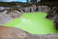 The Devil's Bath, Waiotapu Thermal Area, near Rotorua, north island, New Zealand.  The color of the water is the result of water from the Champagne Pool mixing with sulphur and ferrous salts.  The color changes from green to yellow depending on the amount of reflected light and the cloud cover.