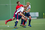 GER - Mannheim, Germany, April 28: During the men field hockey 1. Bundesliga match between Mannheimer HC (red) and Duesseldorfer HC (white) on April 28, 2018 at Am Neckarkanal in Mannheim, Germany. Final score 5-3. (Photo by Dirk Markgraf / www.265-images.com) *** Local caption *** Lucas Vila #12 of Mannheimer HC, Per Pink #18 of Duesseldorfer HC, Linus Mueller #5 of Duesseldorfer HC