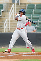 William Carmona (23) of the Lakewood BlueClaws follows through on his swing against the Kannapolis Intimidators at CMC-Northeast Stadium on August 14, 2013 in Kannapolis, North Carolina.  The Intimidators defeated the BlueClaws 10-2.  (Brian Westerholt/Four Seam Images)