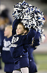 Cassidy Caudill, 6, cheers with Nevada Cheerleader's Perform with the Pack youth program before the start of an NCAA college football game between Nevada and San Jose State, in Reno, Nev., on Saturday, Nov. 16, 2013. (AP Photo/Cathleen Allison)