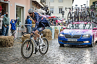 Jimmy Janssens (BEL/Alpecin-Fenix) trying to get his rain jacket on while crossing the town of Cormons in the rain<br /> <br /> 104th Giro d'Italia 2021 (2.UWT)<br /> Stage 15 from Grado to Gorizia (147km)<br /> <br /> ©kramon