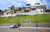 A general view of the Brazilian flag on a hill below some Favelas in Salvador, one of the 12 host cities of the 2014 FIFA World Cup