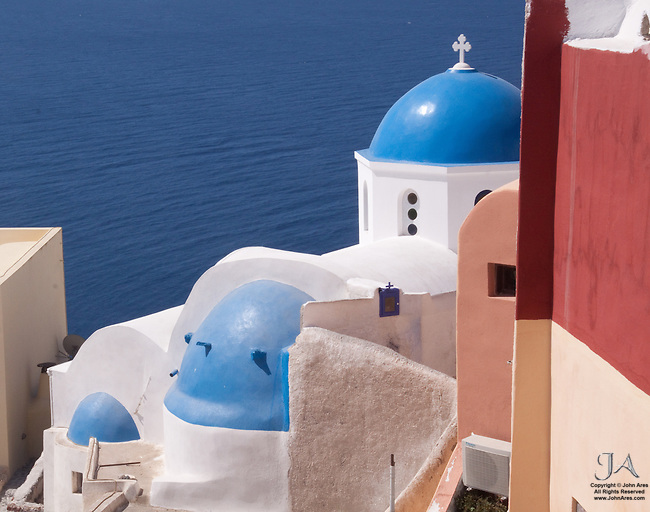 Pastel buildings in Oia with Church