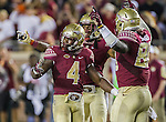 Dalvin Cook, left, Tyler Hunter, second from left, and Marvin Saunders celebrate as time runs out of an NCAA college football game against Miami in Tallahassee, Fla., Saturday, Oct. 10, 2015.   The Florida State Seminoles defeated the Miami Hurricanes 29-24.